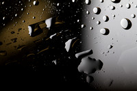 OLD81studios_IMG_0456_water_drops_on_glass_that_looks_as_if_shot_from_outer_space