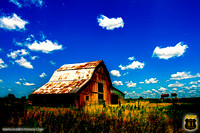 Red barn in Kansas with a deep blue sky