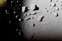 Old81studios_IMG_0438_water_drops_on_glass_that_looks_as_if_shot_from_outer_space